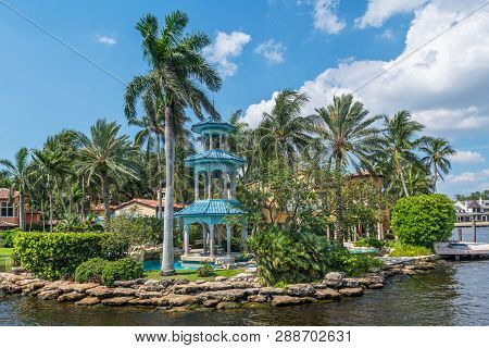 Fort Lauderdale, Florida - July 14 - A Beautiful Oriental Gazebo Surrounded By Palm Trees And The Ca