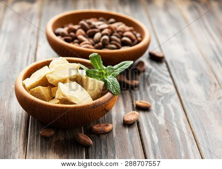 Natural Cocoa Butter And Cocoa Beans On A Old Wooden Background