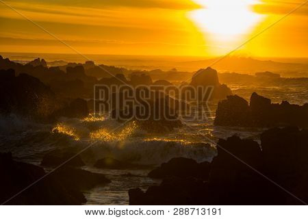 Ocean wave crashing sunset scene background yellow orange