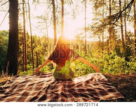 Girl Enjoying In The Nature With Arms Wide Open. Happy Young Woman Taking Deep Breath In The Forest.