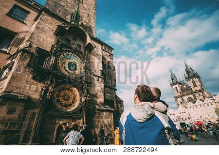 Prague, Czech Republic - October 9, 2014: The Unrecognizable Man And Boy Are Looking At Astronomical