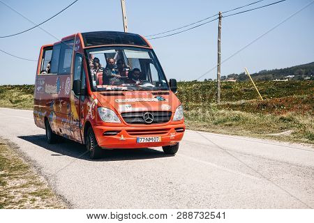 Portugal, Sintra, June 26, 2018: A Tourist Bus Or Minibus Transports Tourists From Sintra To Cape Ro
