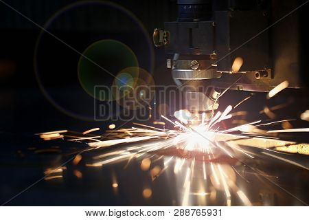 Sparks Fly Out Machine Head For Metal Processing Laser Metal On Metallurgical Plant Background. Manu