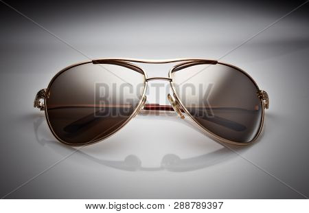 Sunglasses isolated on a white background. Classic design. Protection of eyes against the UV radiation of the sun