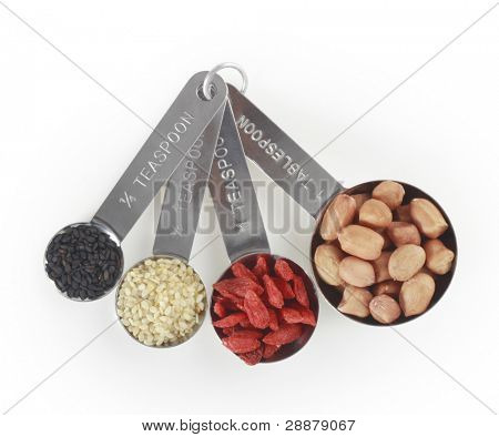 various cereals and seasoning in  spoons