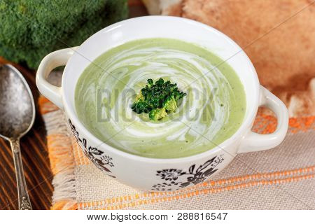 Beautiful Vegetarian Brocoli Soup In A White Bowl