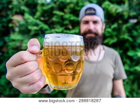 Craft beer is young, urban and fashionable. Creative young brewer. Distinct beer culture. Hipster brutal bearded man hold mug cold fresh beer. Man enjoying beer in summer. Alcohol and bar concept poster