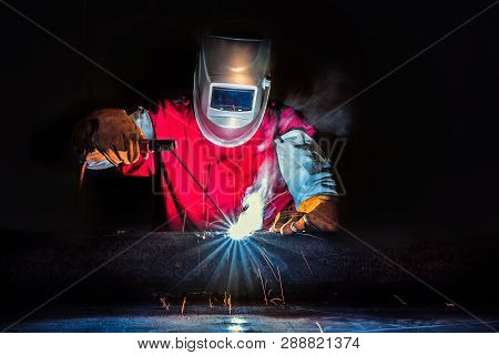Welder-worker Welding And Cutting Steel In Workshop Of Construction Site With Oxy-propane Cutting An