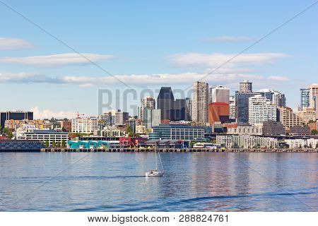 A Motorboat In Puget Sound Bay Waters And Seattle Downtown On Background. Seattle Pier And Skyscrape