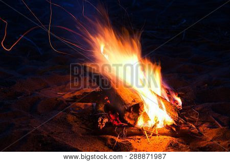 Beach Bonfire Night, Flames And The Darkness Of The Night