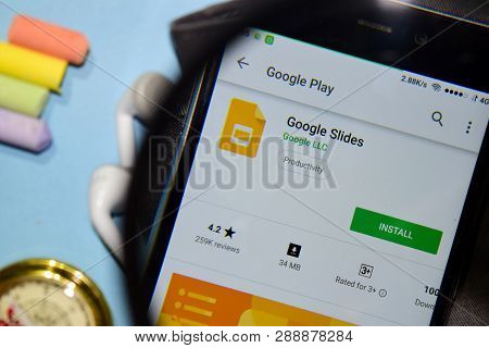 Bekasi, West Java, Indonesia. March 12, 2019 : Google Slides Dev App With Magnifying On Smartphone S