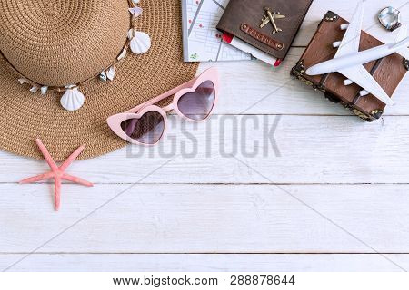 Beach Hat With Travel Items On White Wooden Background, Summer Vacation Concept