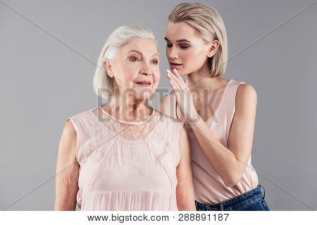 Good-looking Short-haired Blonde Woman Sharing Exclusive Information