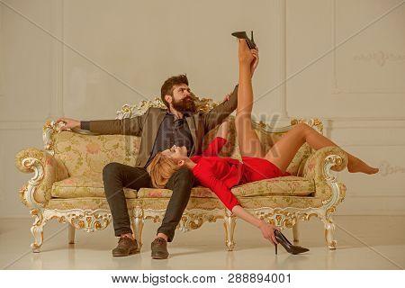 Girlfriend And Boyfriend Relax On Couch. Sexy Girlfriend Has Slim Legs. Bearded Boyfriend Undress Gi