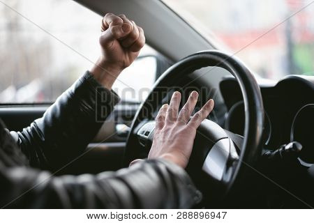 Angry Driver Is Honking And Is Yelling By Sitting Of A Steering Wheel. Road Aggression Concept. Traf