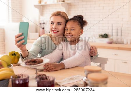 Loving Caring Mother Making Selfie With Her Daughter