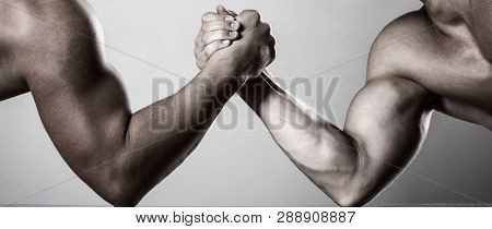 Two Men Arm Wrestling. Rivalry, Closeup Of Male Arm Wrestling. Two Hands. Men Measuring Forces, Arms