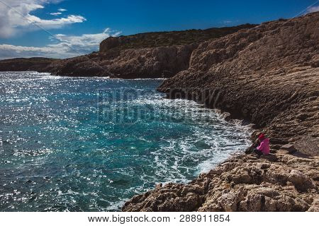 Llittle Girl Is Standing And Looking At The Sea On Beautiful Sea Shore In Cyprus. Beautiful Sea Shor