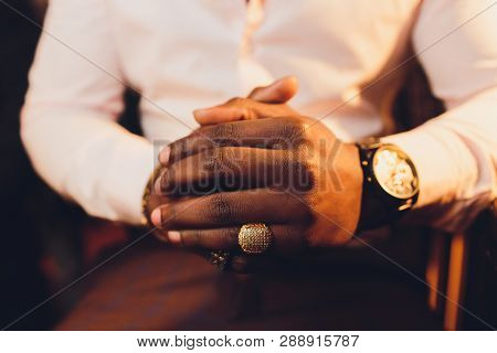 Close Up Or Closeup Of Hands Of Faithful Mature Man Praying. Hands Folded, Interlaced Fingers In Wor