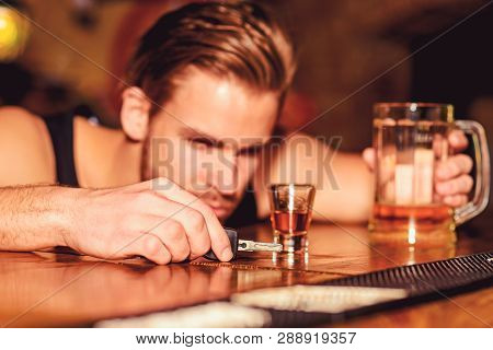 Do Not Drive Drunk. Man Drinker With Car Keys In Pub. Handsome Man Drink Beer At Bar Counter. Alcoho