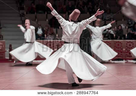 Unidentified whirling Dervishes or Semazen in Konya, Turkey poster