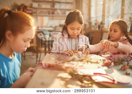 Multi-ethnic Group Of Little Girls Creating Spring Wraths And Decorations Made Of Flowers In Art Cla
