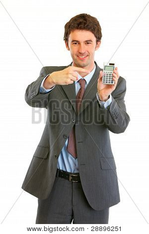 Smiling Modern Businessman Pointing Finger On Calculator