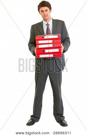 Unhappy Modern Businessman Holding Stack Of Folders