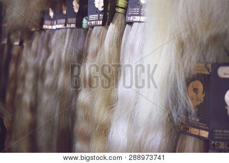 Kiev, Ukraine - 19 September, 2018: Clip-in Hair Extensions  Equipment Of Natural Hair. Hair Ombre B