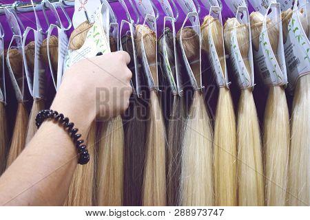 Kiev, Ukraine - 19 September, 2018: Women Choose Clip-in Hair Extensions Equipment Of Natural Hair.
