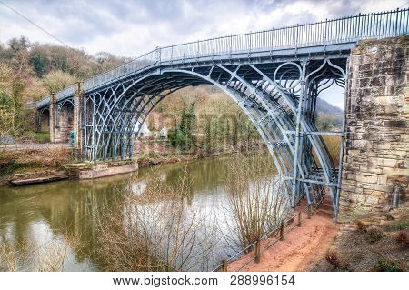 The Famous And Ancient Iron Bridge Rises Over The River Severn In Shropshire, England.