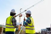 Construction engineers discussion with architects at construction site or building site of highrise building with Surveying for making contour plans is a graphical representation of the lay in land. poster