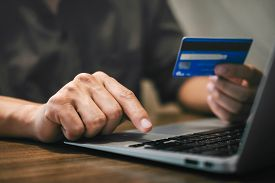 Businessman Holding Credit Card And Typing On Laptop For Online Shopping And Payment Makes A Purchas