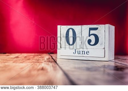 June 5th. Day 5 Of Month, Calendar On Business Office Table, Workplace With Vivid Maroon Red Backgro