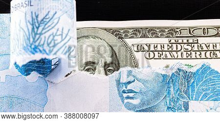 Banknote Of 100 Reais From Brazil Hiding An American Hundred Dollar Bill, Concept Of Valued American
