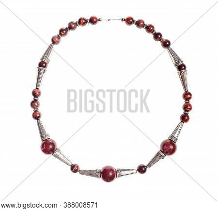 Handcrafted Necklace From Brown Agate Balls, Ox's Eye Beads And Silver Inserts Isolated On White Bac