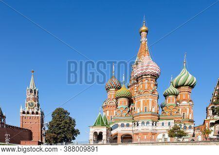 Vasily The Blessed (saint's Basil, Pokrovsky) Orthodox Cathedral And Spasskaya Clock Tower In Kremli