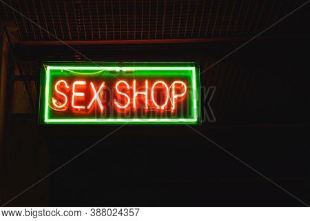 Red And Green Sex Shop Sign. Close Up Of Sex Shop Sign At Night.