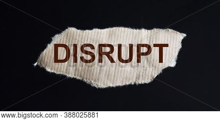 Word Disrupt On A Piece Of Brown Paper And Black Background