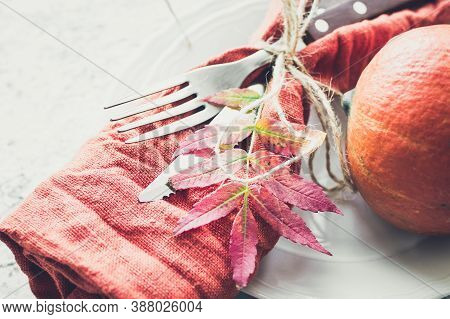 Thanksgiving Autumn Place Setting With Cutlery And Arrangement Of Fall Leaves On Grey Background. Th