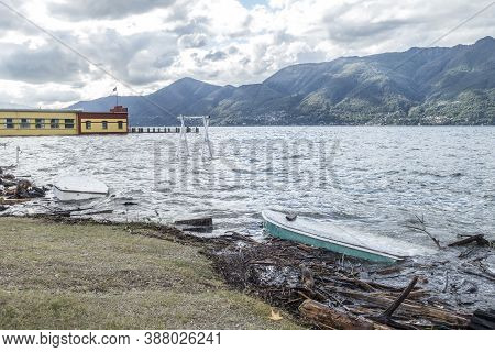 Overturned Boat And Submerged Swing From Lake Maggiore In Flood In Germignaga
