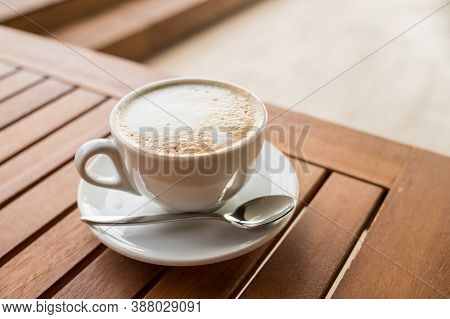 Ceramic Cup Of Coffee On Table In Coffee Shop Cafe.coffee Cup Latte Art In Cafe On Wooden Table.clas