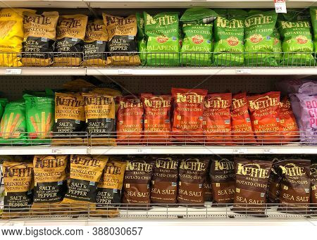 Alameda, Ca - Aug 04, 2020: Grocery Store Shelves With Bags Of Kettle Brand Potato Chips In Various