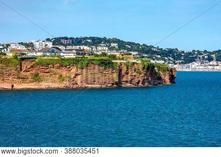 Permian Red Sandstone Cliffs In The Town Of Torquay Devon England Uk Showing Strata And A Partially-