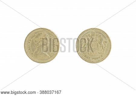 Close Up Of One Old Shiny British Pound Coin, Front And Back. Isolated On White. It Has Featured The