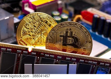 Virtual Cryptocurrency Money Bitcoin Golden Coins On A Computer Printed Circuit Board Pcb. The Futur