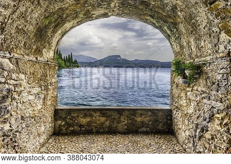 Scenic Rock Arch Balcony Overlooking Lake Garda From The Town Of Torbole, Italy