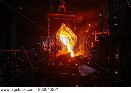 Metal Casting Process In Metallurgical Plant. Liquid Metal Pouring Into Molds