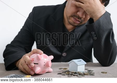 Businessman Is Stressed Out Of Losing Their Jobs And Insufficient Savings To Pay For A Mortgage. Foc