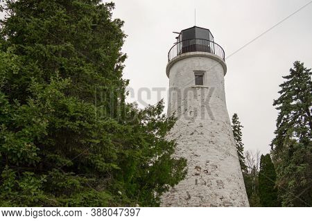Old Presque Isle Lighthouse In Michigan. The Presque Isle Lighthouse Was Built In 1840 And Is Report